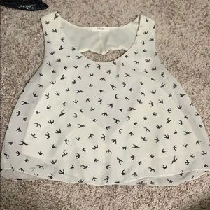 white tank with a heart cut out in the back